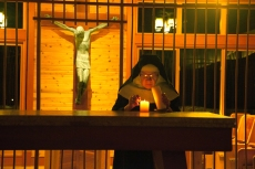 Mother Therese lighting candles